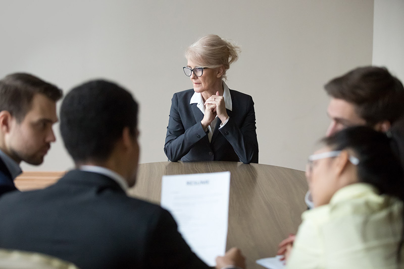 Older woman left out of work meeting age discrimination