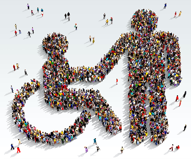 people standing in the shape of the disability symbol